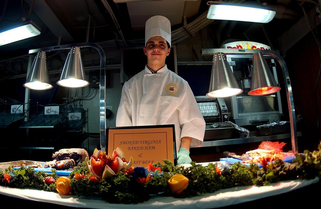 Showcase photographs of your chef with a smile